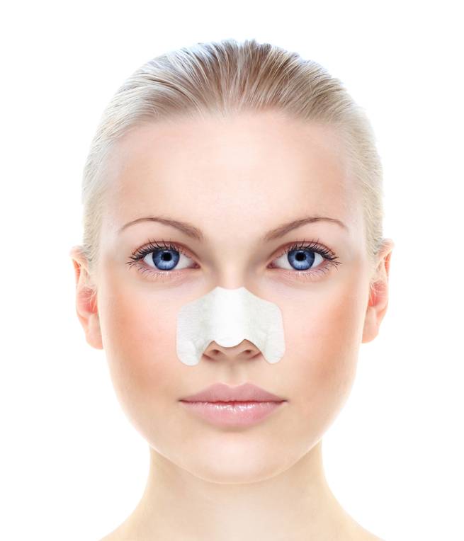 Beautiful woman's portrait with plaster on nosebleed nose isolat